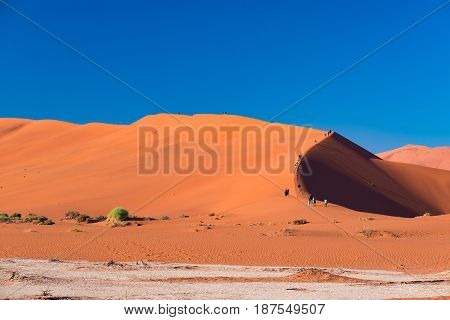Tourists Climbing The Scenic Sand Dunes In Sossusvlei, Namib Naukluft National Park, Best Tourist An