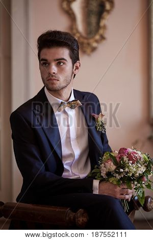 groom looking and thinking  on a sofa