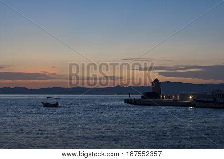 Breakwater with lighthouse in Postira on Brac island