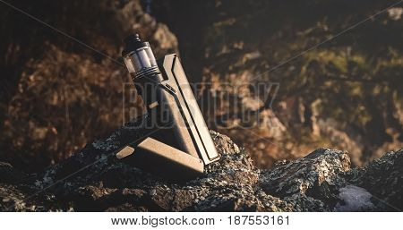 close-up of the vaporizer in the mountains in a landscape