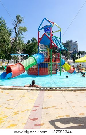 Gelendzhik Russia - July 30 2016 - Children and adults swimming in the pool at the water Park in the summer