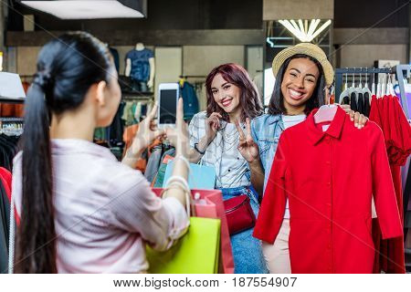 Multicultural Hipster Girls Taking Photo In Boutique, Fashion Shopping Girls Concept