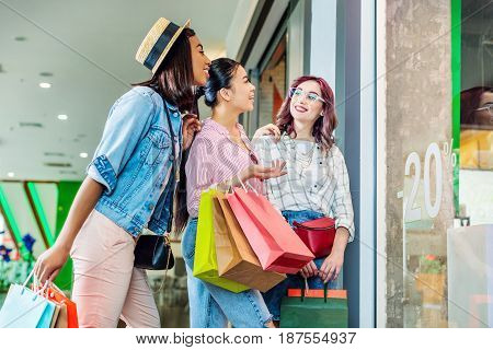 multicultural hipster girls with shopping bags in shopping mall friends shopping concept