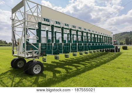 Start gates for horse races in sunny day.