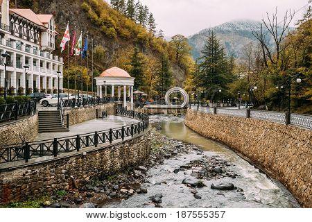Borjomi, Samtskhe-Javakheti, Georgia. Hotel House And Pedestrian Bridge Over River Borjomi In Shape Of A Mobius Or Moebius Loop Or Strip.