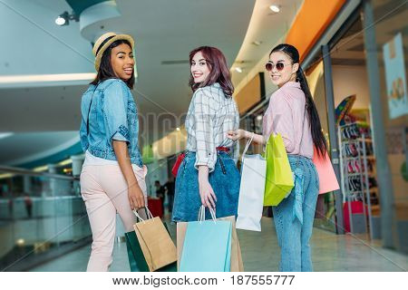 Happy Stylish Young Women With Shopping Bags Walking In Shopping Mall, Young Girls Shopping Concept