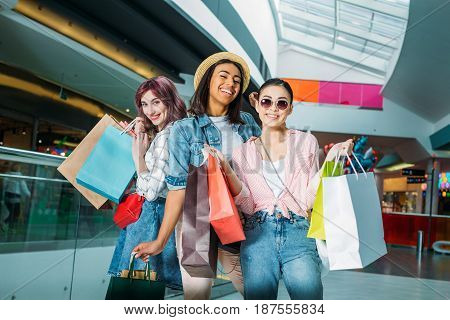 Happy Stylish Young Women With Shopping Bags Posing In Shopping Mall, Young Girls Shopping Concept