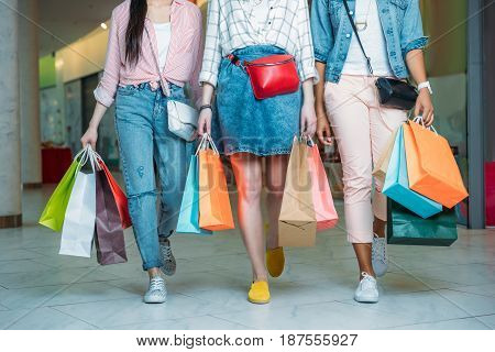 Cropped Shot Of Young Women With Shopping Bags Walking In Shopping Mall, Young Girls Shopping Concep