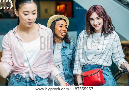 Happy Young Stylish Women Walking Together In Shopping Mall, Young Girls Shopping Concept