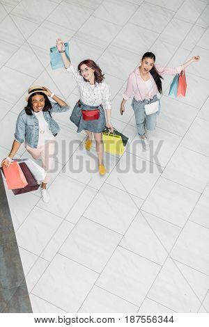 High Angle View Of Stylish Young Women Walking With Shopping Bags, Young Girls Shopping Concept