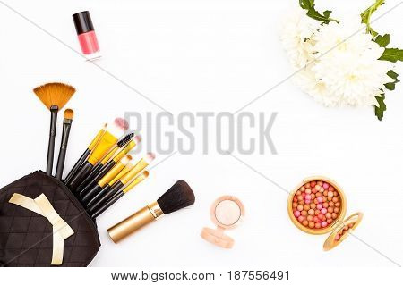 Makeup Brushes, Pink Nail Polish, Chrysanthemum Flower And Other Accessories On A White Background.