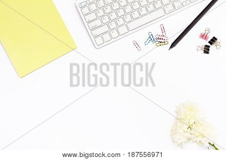 Keyboard, Yellow Notepad, Chrysanthemum Flower, Clips For Papers, Paper Clips And Black Pencil On A