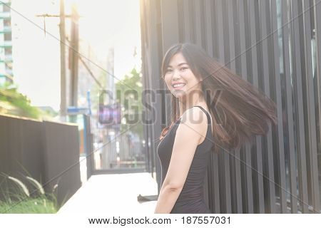 Beautiful Women Flick The Healthy Long Hair While Sunset Light