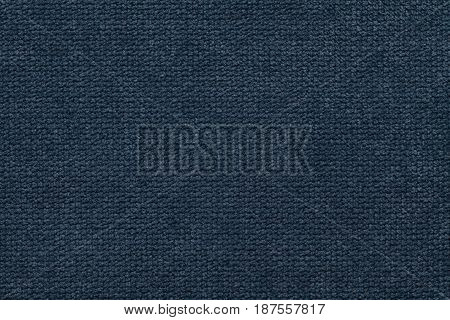 Navy blue background of soft fleecy cloth. Texture of light dark denim nappy textile closeup.