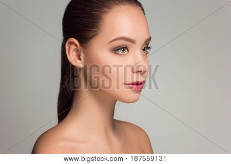 Beautiful woman face portrait close up on blue background