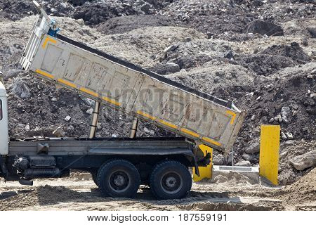 Tipping Truck At Construction Site