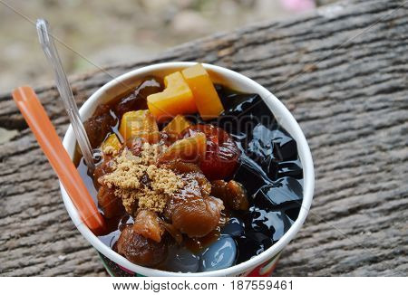 assorted Chinese cold sweetmeat with ice in paper cup