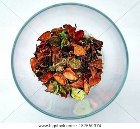 dried flower petals in a clear vase