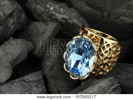 jewelry ring witht big gemstone on dark coal background