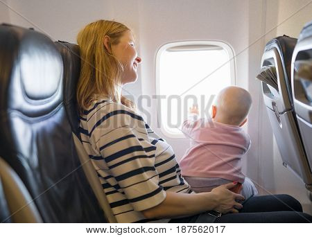 Mother and baby traveling on the plane