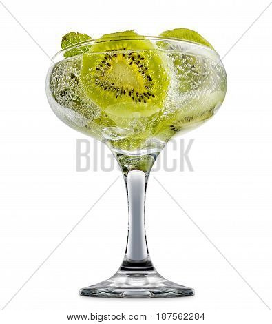 fresh fruit alcohol cocktail or mocktail in margarita glass with ice cubes, kiwi and mint isolated on white background