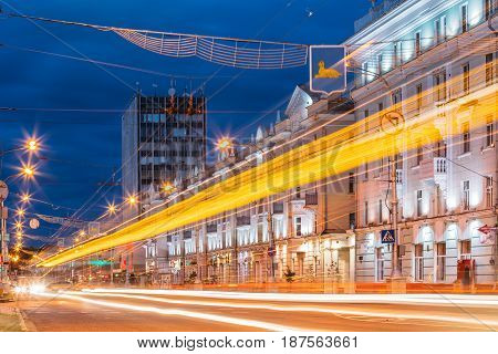Gomel, Belarus - July 19, 2016: Speed Traffic And Light Trails On Lenin Avenue Street In Eveining Or NIght. Long Exposure