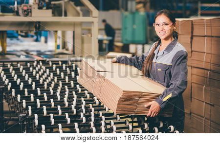 box producing at a paper mill factory storage