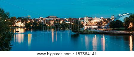 Minsk, Belarus - September 3, 2016: Famous Landmarks At Summer Evening In Night Lights Illumination. Trinity Suburb Or Trojeckaje Pradmiescie And Cathedral Of Holy Spirit At Blue Hour