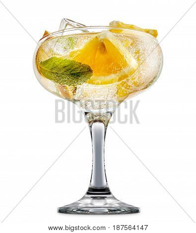 fresh fruit alcohol cocktail or mocktail in margarita glass with ice cubes, orange and mint isolated on white background