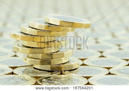 Precariously Balanced Stack Of British One Pound Coins.