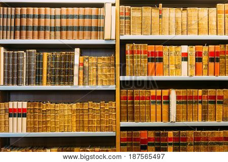 Aged Ancient Antique Old Vintage Books On A Shelfs In Library.