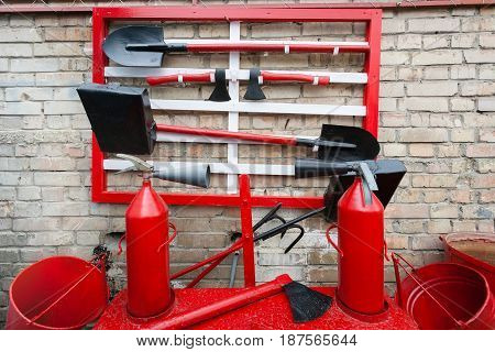 The fire shield is red. Items for fighting fire: shield, ax, bucket, hook.