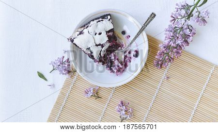 Tender homemade baking blueberry pie with lilac and tea