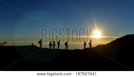 Mountaineering activities & People watching the sunrise