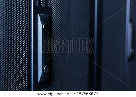 Limited access. Close up of a button locking the door in the data center