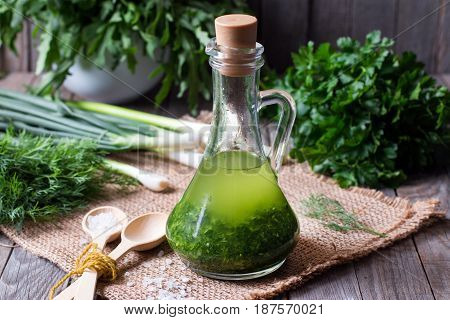 Green healthy oil on a wooden table