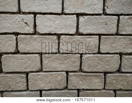rectangle brown brick wall. background. wallpaper. building. photo.