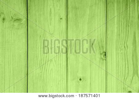 green wooden boards with knots close up