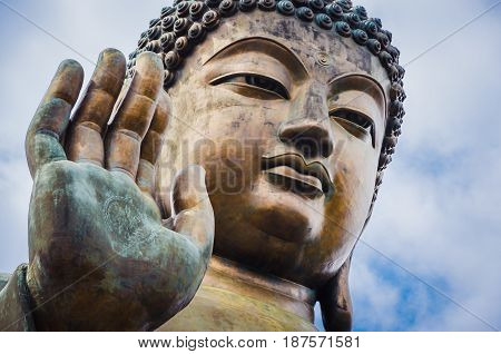 Close up of Tian Tan Buddha with details of hand - The worlds's tallest outdoor seated bronze Buddha located in Lantau Island, Hong Kong, China.