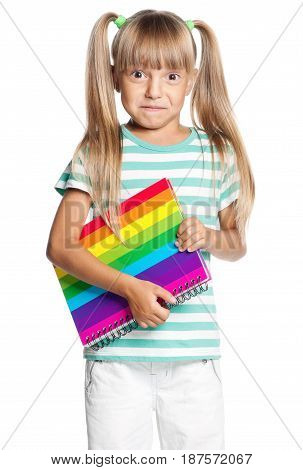 Little girl with exercise book, isolated on white background
