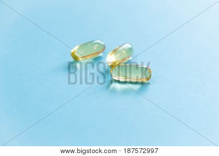 Fish oil omega 3 and vitamin D capsules in a plastic bottle on a white background healthy diet concept