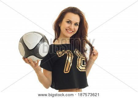 charming cheerful fitness girl holding a ball and a smiling close-up of isolated on white background