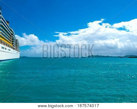 View with a cruise liner at the port of Tortola Island of British Virgin Islands. The image blurred in postproduction