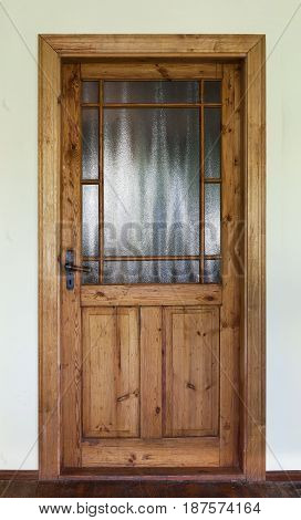 Brown wood old door with decorative glass