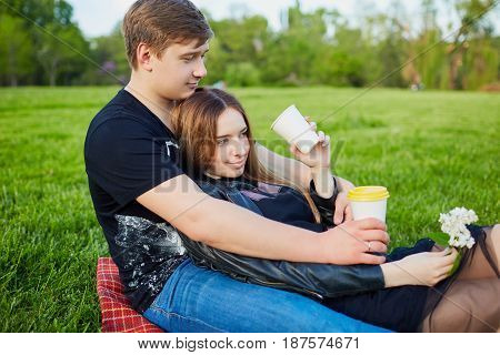 A loving couple in the park. Valentine's Day.