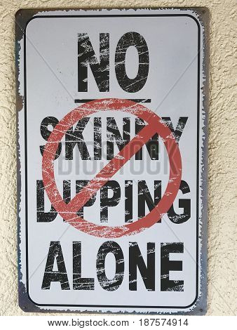 Metal, weather resistant no skinny dipping porch sign