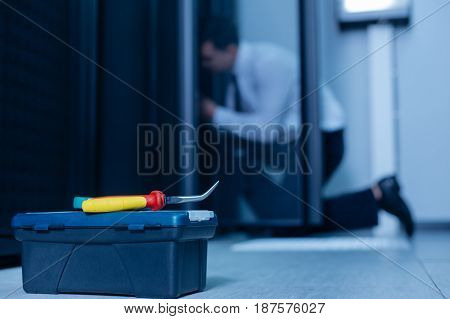 Box with instruments. Selective focus of a special screwdriver for repairing data servers lying on the box