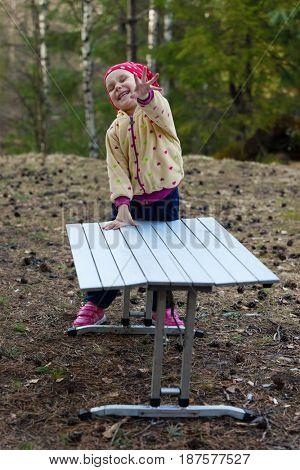 laughing girl in wood. Joyful emotions