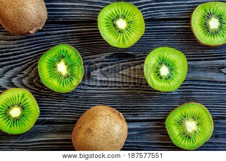 healthy green food with kiwi on dark wooden desk background top view pattern