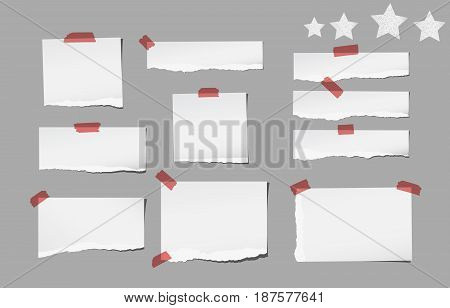 Ripped white note, notebook, copybook paper strips stuck with sticky tape, stars on gray background